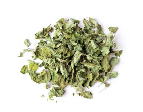 dry moringa leaves on white background