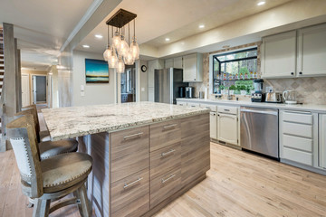 Luxury home dining room and kitchen interior with natural rustic modern deisgn.