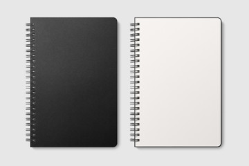 Foto auf Acrylglas Spirale Real photo, spiral bound notepad mockup template with black paper cover, isolated on light grey background. High resolution.