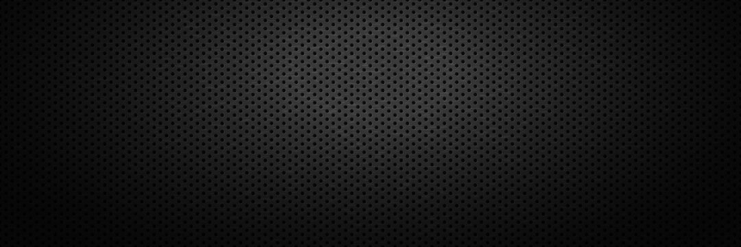 Black metal perforated backdrop with spot of light