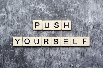 Push yourself motivation formed with plastic tiles