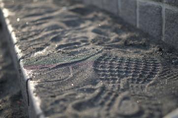 海岸の階段に残る靴跡 Footprints on stairs on the coast Wall mural