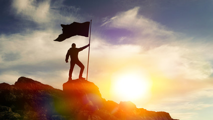 Man with flag on top of the mountain against the sky. Concept business ideas, success and achievement, winner leader. Wall mural