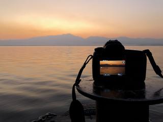 Camera capturing beautiful colorful sky sunrise photo.