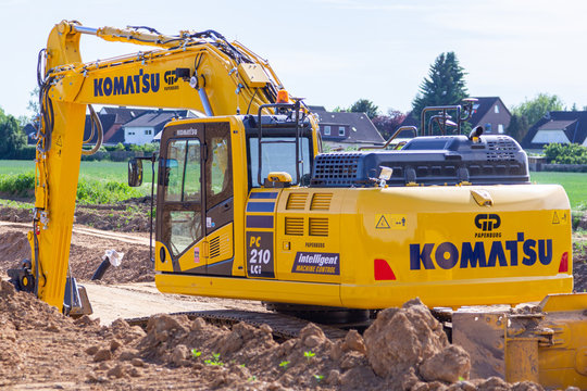 HANOVER / GERMANY - JUNE 2,2019: Komatsu excavator stands on a construction site in Hanover.