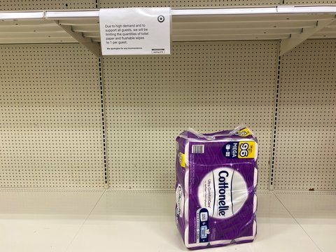 Eau Claire, Wisconsin - March 30, 2020: Toilet paper is nearly out of stock on the shelves at a Target store. Sign limiting quantities for customers due to COVID-19 Corona Virus