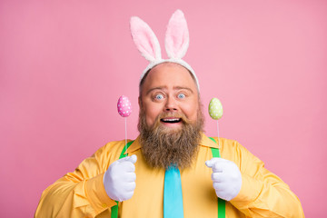 Close-up portrait of his he nice cheerful cheery funky glad bearded guy wearing bunny ears holding...
