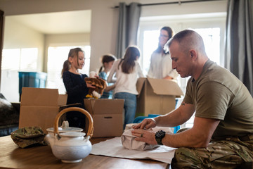 Military family packing belongings to move