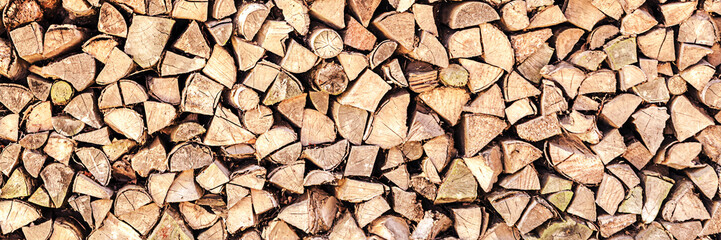 logs of firewood stacked on country yard in big pile outdoor Fotomurales