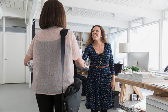 Female manager greeting woman for job interview