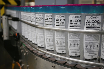 A machine labels bottles of ethanol-based hand sanitizers at the L'Oreal Brasil plant produced for donation to hospitals and poor communities during the coronavirus disease (COVID-19) outbreak in Sao Paulo