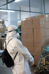 Fototapeta Corona spraying man in factory