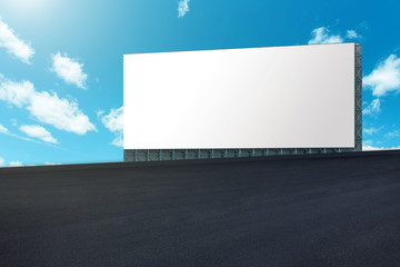 Fotomurales - Large billboard on road with blue sky