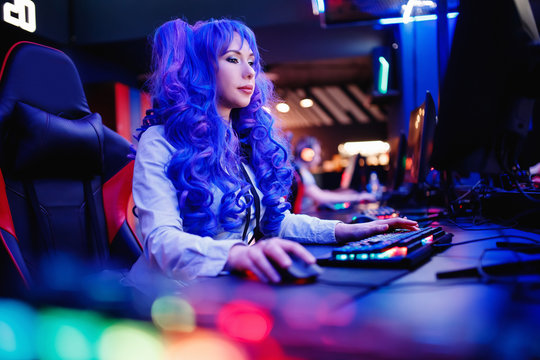 Young woman streamer anime cosplay professional gamer playing video online games computer
