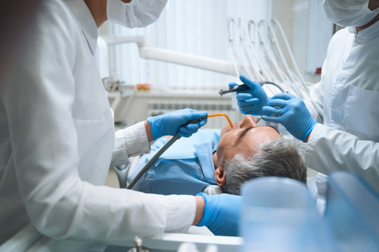 Two dentists are treating male stock photo
