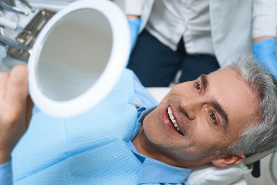 Happy man after dental procedures stock photo