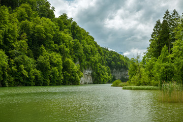 Wall Mural - Wichelsee lake surrounded by steep cliffs from one side