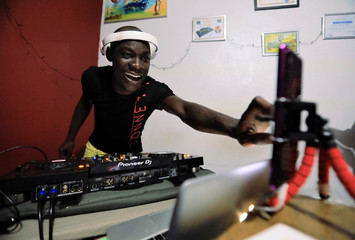 DJ Arsenal performs from his home during the curfew to stop the spread of coronavirus disease (COVID-19), in Yopougon