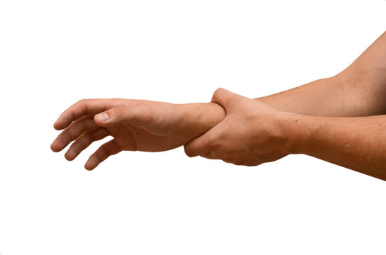 Man suffers from wrist pain, isolated. Causes of pain include sprains in the wrist. Healthcare concept.