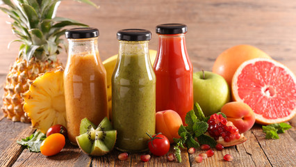 colorful healthy smoothies and juices in bottle