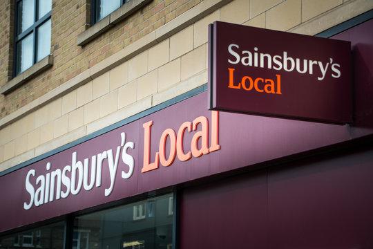 London- Sainsbury's Local,  British supermarket chain high street shop signage