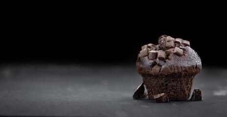 Fresh made Chocolate Muffins on a slate slab (close-up shot; selective focus) Fototapete