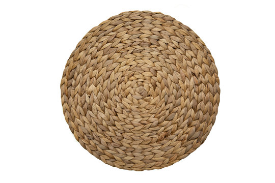 Round woven straw mat isolated against white background