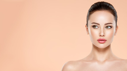 Beautiful face of young woman with health fresh skin. Portrait of beautiful  brunette woman with...