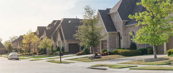 Panoramic view upscale residential neighborhood with two story houses in suburbs Dallas, Texas