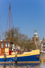 Fotomurales - Old ship and church tower in the center of Meppel, Netherlands