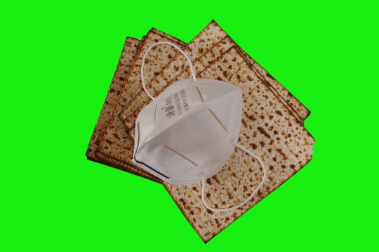 Matzah - Traditional Jewish food for Passover is covered in a mask against the Corona virus.