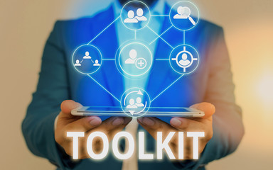 Text sign showing Toolkit. Business photo showcasing set of tools kept in a bag or box and used for a particular purpose