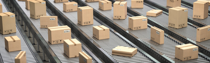 Cardboard boxes on the conveyor belt. Production, storage and delivery concept background.