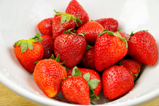 A bowl of freshly washed strawberries
