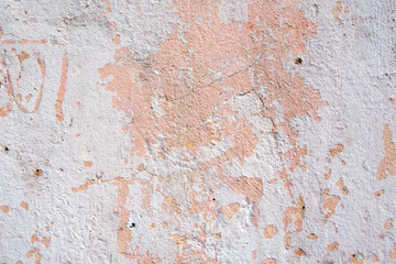 Fotobehang Oude vuile getextureerde muur Background of old cracked pastel color paint on cement wall.