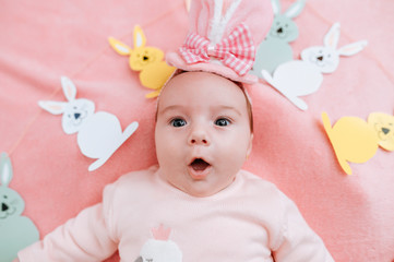 Baby with hat and rabbit garland