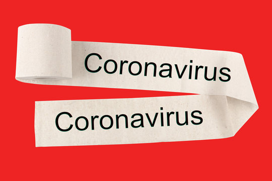 Unwound a toilet paper roll with the text Coronovirus, on a red background. The concept of warning and mass hysteria.