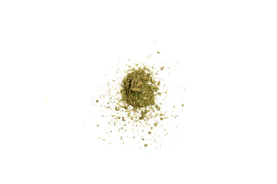 Pile of shredded marijuana with little bud on top. Shredded cannabis and small cannabis bud isolated on white background.