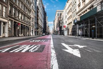 Empty Broadway asphalt street with bus public transport lane in SoHo district in Manhattan, New York City Wall mural
