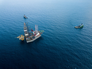 Wall Mural - Aerial view offshore jack up rig and a tow vessel at the offshore location