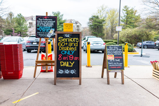 Reston, USA - April 1, 2020: Trader Joe's grocery store sign for senior disabled customers special morning hours, people limit and grocery bagging paper bag restriction at covid-19 coronavirus