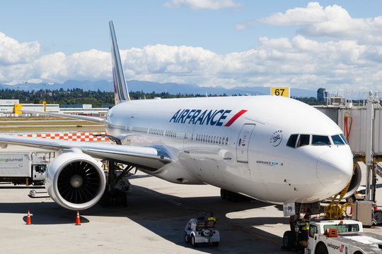Air France plane being serviced on the tarmac of Vancouver International Airport