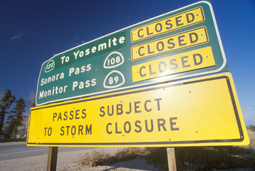Wall Mural - A sign that reads ÒPasses subject to storm closureÓ