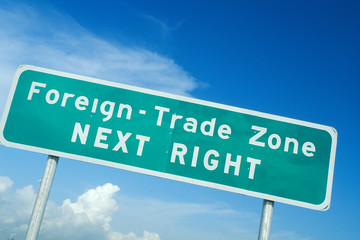 Wall Mural - A sign that reads ÒForeign trade zone next rightÓ