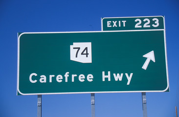 Fototapete - A sign that reads ÒCarefree HwyÓ