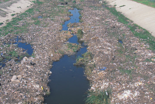 An undesignated urban dump on the Los Angeles River in Compton, California