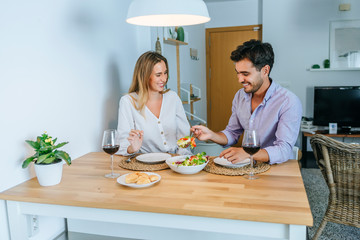 Couple having lunch in the living room of the home