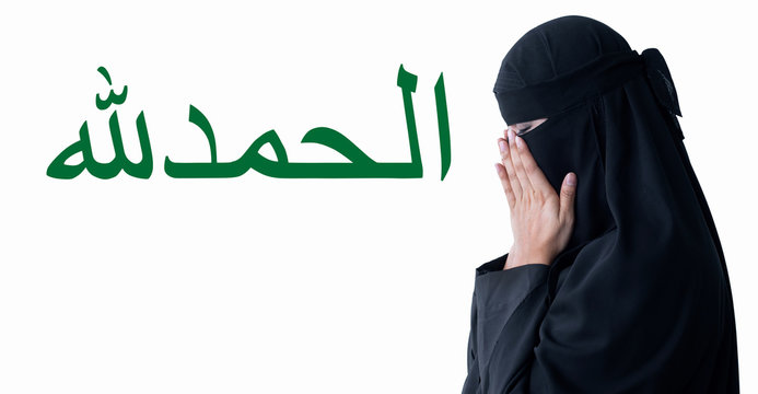 """Muslim woman praying for god to bless her on white background, with clipping path, Arabic Calligraphy mean """"Alhamdulillah"""" All Praise Be to God"""