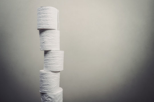Stack of toilet paper rolls hoarding concept, grunge style image