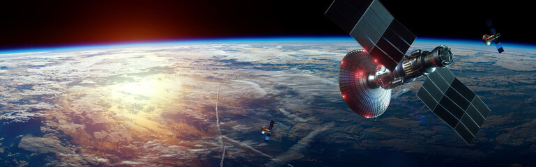 Space satellite with antenna and solar panels in space against the background of the earth. Telecommunications, high-speed Internet, space exploration. copy space. image furnished by NASA